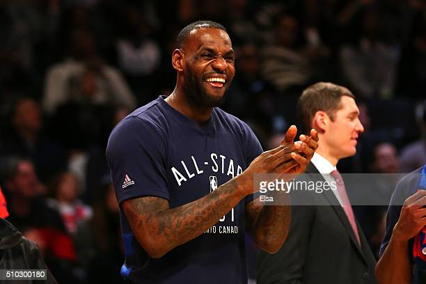 LeBron James of the Cleveland Cavaliers and the Eastern Conference reacts on the bench in the second half against the Western Conference during the...