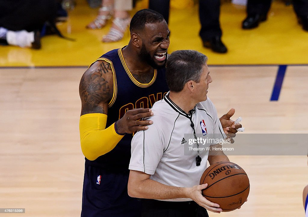 LeBron James of the Cleveland Cavaliers argues a call with referee Scott Foster in overtime against the Golden State Warriors during Game Two of the...