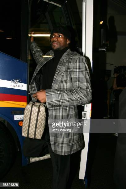 LeBron James of the Cleveland Cavaliers arrives at Key Arena to take on the Seattle SuperSonics on December 2 2005 in Seattle Washington NOTE TO USER...
