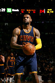 LeBron James of the Cleveland Cavaliers attempts a free throw against the Boston Celtics in Game Three of the Eastern Conference Quarterfinals during...