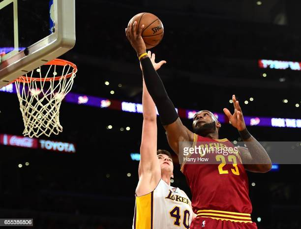 LeBron James of the Cleveland Cavaliers attempts a layup over Ivica Zubac of the Los Angeles Lakers at Staples Center on March 19 2017 in Los Angeles...