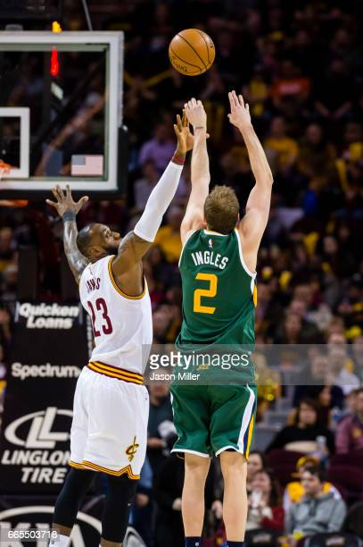LeBron James of the Cleveland Cavaliers attempts to block Joe Ingles of the Utah Jazz during the first half at Quicken Loans Arena on March 16 2017...