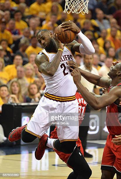LeBron James of the Cleveland Cavaliers battles for the ball against Bismack Biyombo of the Toronto Raptors during the first half in game two of the...