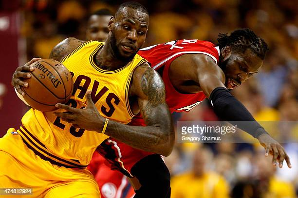 LeBron James of the Cleveland Cavaliers battles for the ball with DeMarre Carroll of the Atlanta Hawks in the first quarter during Game Four of the...