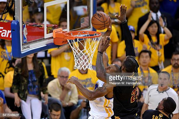 LeBron James of the Cleveland Cavaliers blocks a shot by Andre Iguodala of the Golden State Warriors in Game 7 of the 2016 NBA Finals at ORACLE Arena...