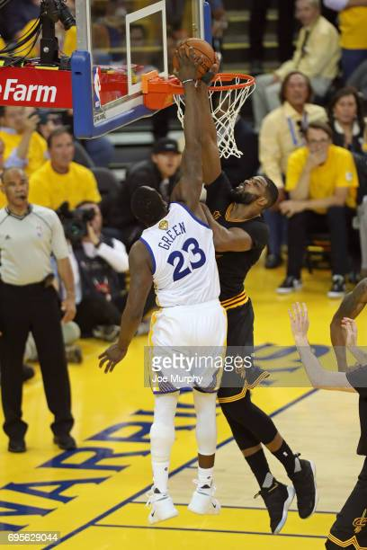LeBron James of the Cleveland Cavaliers blocks the shot of Draymond Green of the Golden State Warriors in Game Five of the 2017 NBA Finals on June 12...