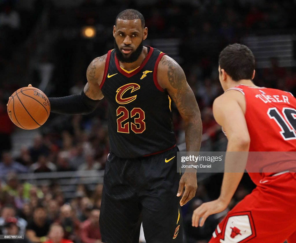LeBron James #23 of the Cleveland Cavaliers brings the ball up the court against Paul Zipser #16 of the Chicago Bulls at the United Center on December 4, 2017 in Chicago, Illinois. The Cavaliers defeated the Bulls 113-91.