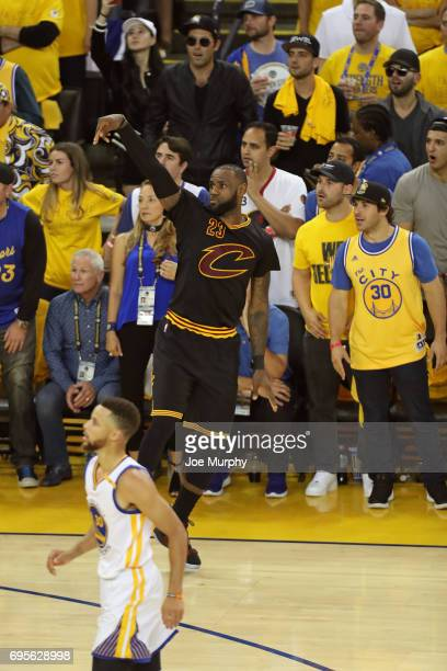 LeBron James of the Cleveland Cavaliers celebrates a three point basket against the Golden State Warriors in Game Five of the 2017 NBA Finals on June...