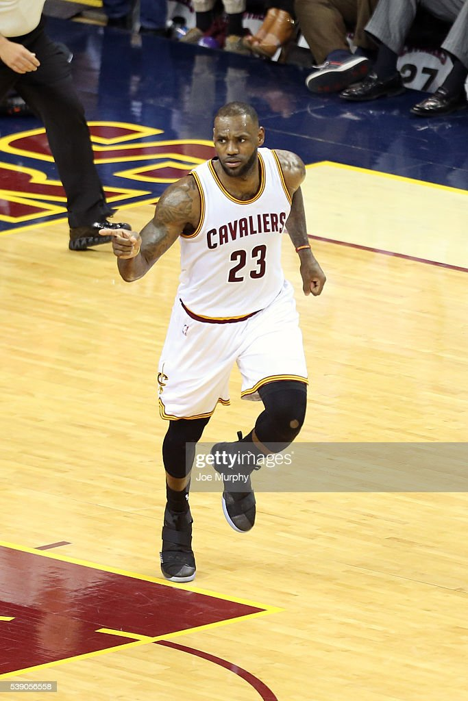 LeBron James of the Cleveland Cavaliers celebrates after dunking the ball against the Golden State Warriors in Game Three of the 2016 NBA Finals on...