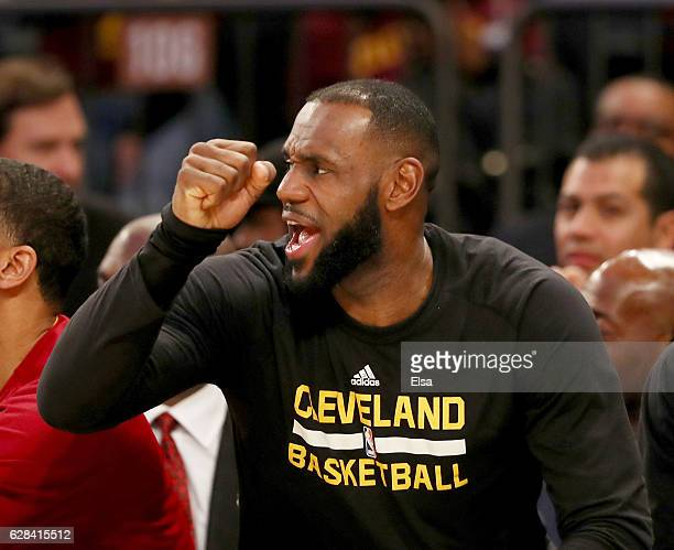 LeBron James of the Cleveland Cavaliers celebrates from the bench in the fourth quarter against the New York Knicks at Madison Square Garden on...