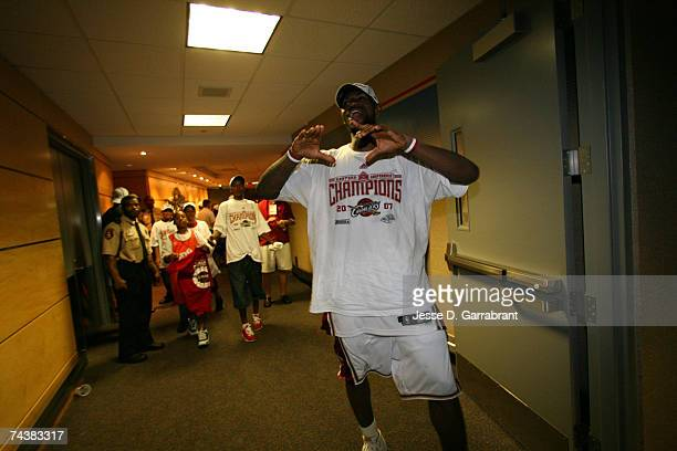 LeBron James of the Cleveland Cavaliers celebrates outside the locker room after defeating the Detroit Pistons in Game Six of the Eastern Conference...