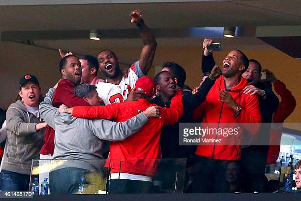 LeBron James of the Cleveland Cavaliers celebrates running back Ezekiel Elliott of the Ohio State Buckeyes two yard touchdown in the fourth quarter...