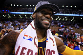 LeBron James of the Cleveland Cavaliers celebrates their 113 to 87 win over the Toronto Raptors in game six of the Eastern Conference Finals during...