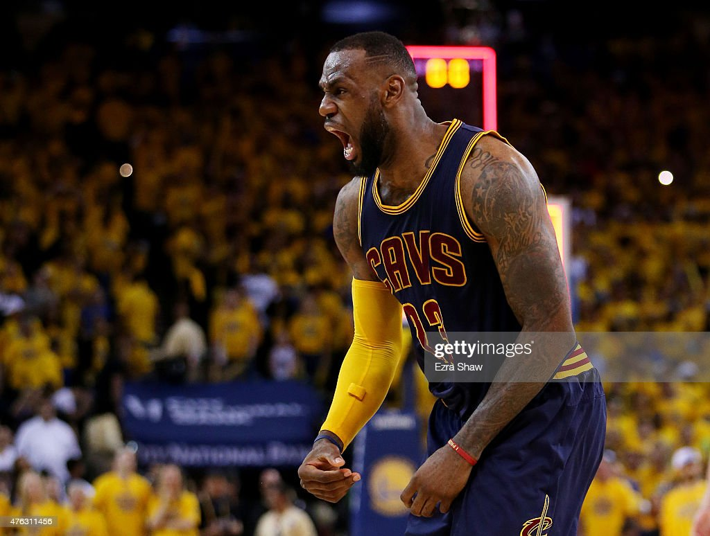 LeBron James of the Cleveland Cavaliers celebrates their 95 to 93 win over the Golden State Warriors in overtime during Game Two of the 2015 NBA...