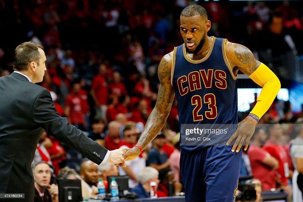 <a gi-track='captionPersonalityLinkClicked' href=/galleries/search?phrase=LeBron+James&family=editorial&specificpeople=201474 ng-click='$event.stopPropagation()'>LeBron James</a> #23 of the Cleveland Cavaliers celebrates their 97 to 89 win over the Atlanta Hawks with head coach <a gi-track='captionPersonalityLinkClicked' href=/galleries/search?phrase=David+Blatt&family=editorial&specificpeople=836616 ng-click='$event.stopPropagation()'>David Blatt</a> during Game One of the Eastern Conference Finals of the 2015 NBA Playoffs at Philips Arena on May 20, 2015 in Atlanta, Georgia.