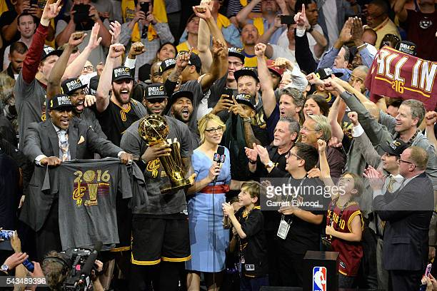 LeBron James of the Cleveland Cavaliers celebrates with his team and the Larry O'Brien NBA Championship Trophy after winning Game Seven of the 2016...