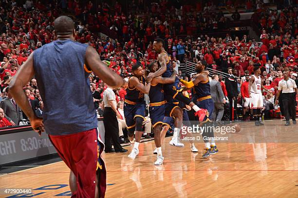 LeBron James of the Cleveland Cavaliers celebrates with his teammates after hitting the game winning shot with 7 seconds left in the game against the...