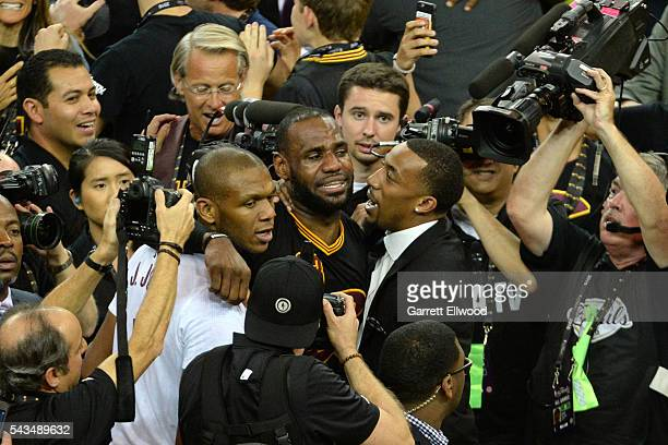 LeBron James of the Cleveland Cavaliers celebrates with his teammates after winning Game Seven of the 2016 NBA Finals against the Golden State...