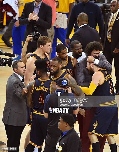 LeBron James of the Cleveland Cavaliers celebrates with Iman Shumpert after defeating the Golden State Warriors in Game Two of the 2015 NBA Finals on...