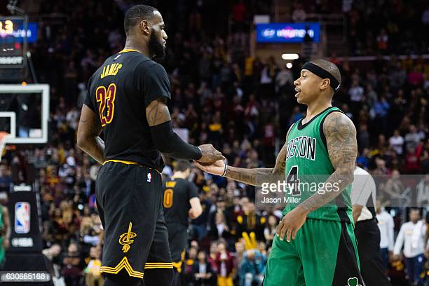 LeBron James of the Cleveland Cavaliers celebrates with Isaiah Thomas of the Boston Celtics during the final seconds second half at Quicken Loans...