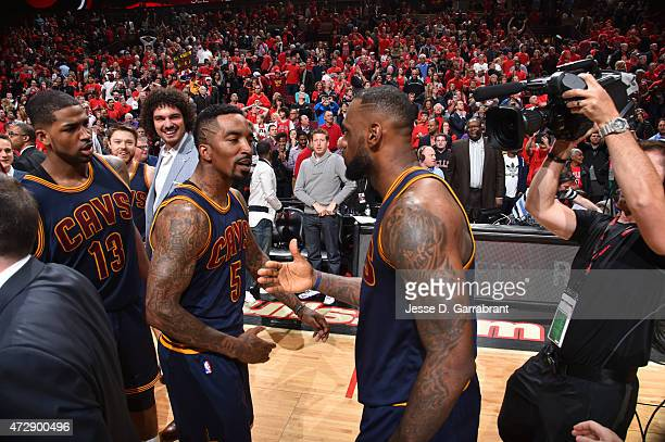 LeBron James of the Cleveland Cavaliers celebrates with JR Smith after hitting the game winning shot with 7 seconds left in the game against the...