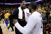 LeBron James of the Cleveland Cavaliers celebrates with teammate Kyrie Irving after defeating the Golden State Warriors in Game 5 of the 2016 NBA...
