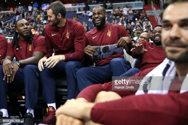 LeBron James of the Cleveland Cavaliers celebrates with teammates as he holds a Greene Turtle restaurant menu after teammate Jeff Green dunked in the...