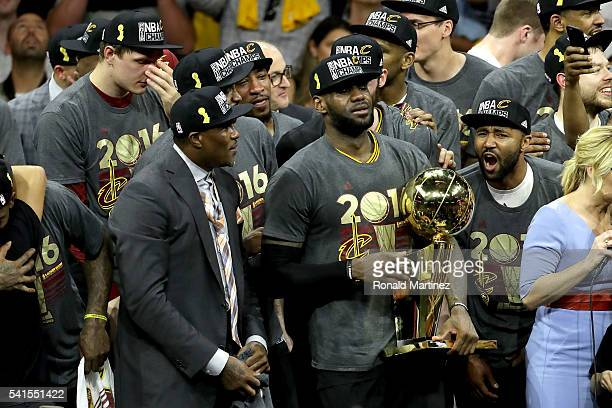LeBron James of the Cleveland Cavaliers celebrates with the Larry O'Brien Championship Trophy after defeating the Golden State Warriors 9389 in Game...