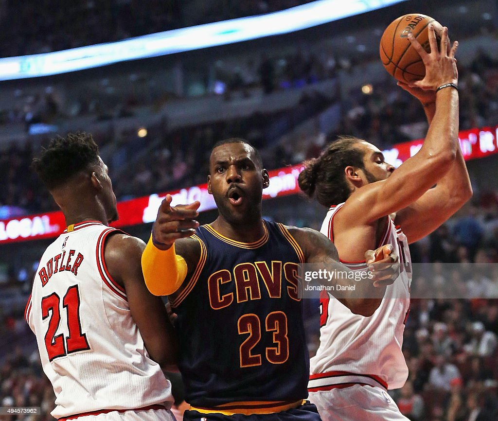 LeBron James #23 of the Cleveland Cavaliers complains to a referee as he is trapped between Jimmy Butler #21 and Joakim Noah #13 of the Chicago Bulls during the season opening game at the United Center on October 27, 2015 in Chicago, Illinois. Note to User: User expressly acknowledges and agrees that, by downloading and or using the photograph, User is consenting to the terms and conditions of the Getty Images License Agreement.