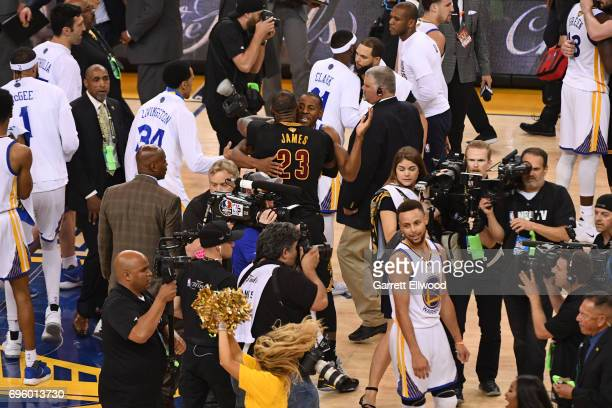 LeBron James of the Cleveland Cavaliers congratulates Andre Iguodala of the Golden State Warriors in Game Five of the 2017 NBA Finals on June 12 2017...