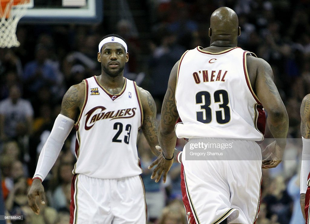 LeBron James of the Cleveland Cavaliers congratulates Shaquille O'Neal after his basket against the Boston Celtics during Game One of the Eastern...