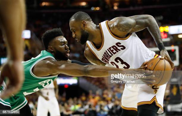 LeBron James of the Cleveland Cavaliers controls the ball against Jaylen Brown of the Boston Celtics in the fourth quarter during Game Four of the...