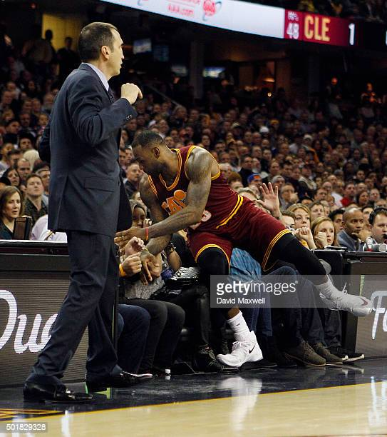 LeBron James of the Cleveland Cavaliers crashes into the stands in pursuit of a loose ball during the second half against the Oklahoma City Thunder...