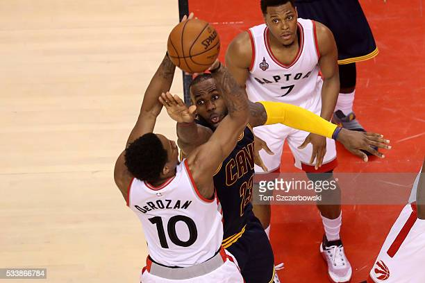 LeBron James of the Cleveland Cavaliers defends DeMar DeRozan of the Toronto Raptors in the third quarter in game four of the Eastern Conference...