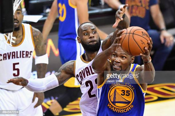 LeBron James of the Cleveland Cavaliers defends Kevin Durant of the Golden State Warriors in the third quarter in Game 4 of the 2017 NBA Finals at...