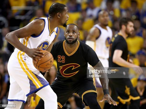 LeBron James of the Cleveland Cavaliers defends Kevin Durant of the Golden State Warriors in Game 5 of the 2017 NBA Finals at ORACLE Arena on June 12...