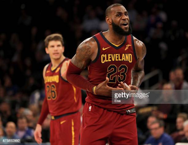 LeBron James of the Cleveland Cavaliers directs his teamamtes in the final minute of the game against the New York Knicks at Madison Square Garden on...