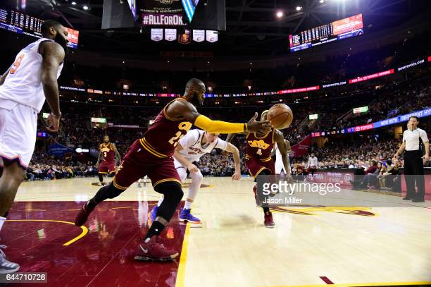 LeBron James of the Cleveland Cavaliers dives for a loose ball during the first half against the New York Knicks at Quicken Loans Arena on February...