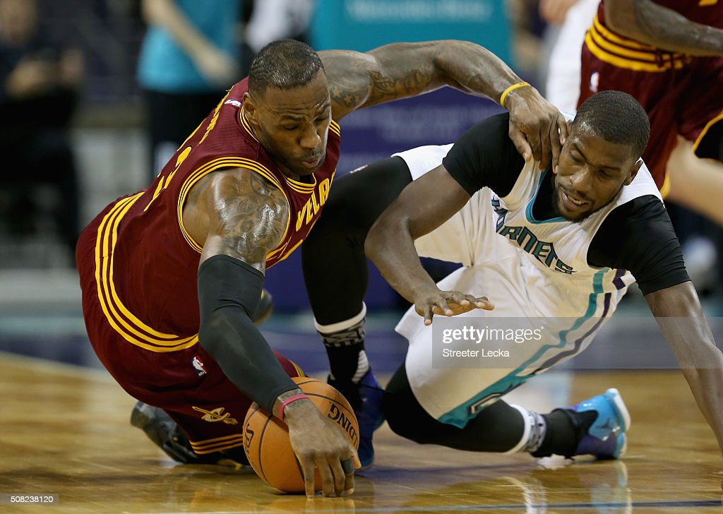 LeBron James #23 of the Cleveland Cavaliers dives for a loose ball against Michael Kidd-Gilchrist #14 of the Charlotte Hornets during their game at Time Warner Cable Arena on February 3, 2016 in Charlotte, North Carolina.