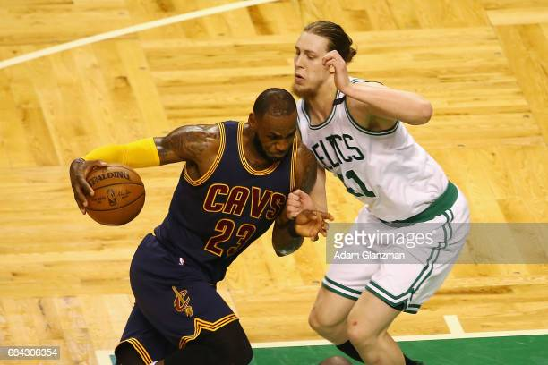 LeBron James of the Cleveland Cavaliers dribbles against Kelly Olynyk of the Boston Celtics in the first half during Game One of the 2017 NBA Eastern...