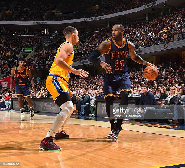 LeBron James of the Cleveland Cavaliers dribbles the ball against Stephen Curry of the Golden State Warriors on January 18 2016 at Quicken Loans...