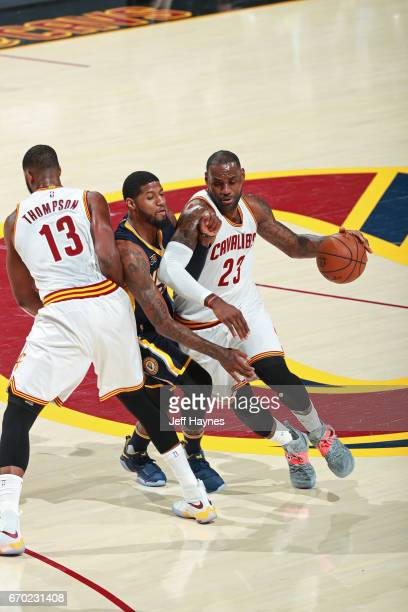 LeBron James of the Cleveland Cavaliers dribbles the ball around a screen while guarded by Paul George of the Indiana Pacers during Game Two the...