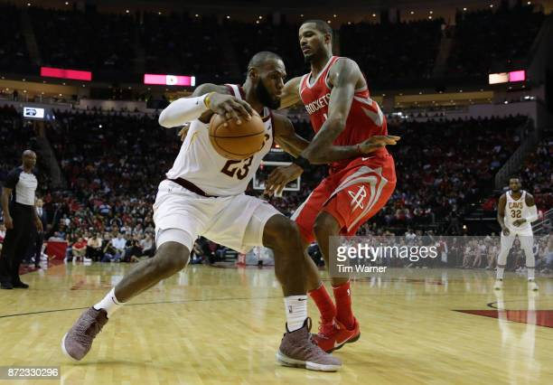 LeBron James of the Cleveland Cavaliers dribbles the ball defended by Trevor Ariza of the Houston Rockets in the second half at Toyota Center on...