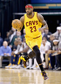 LeBron James of the Cleveland Cavaliers dribbles the ball during the game against the Indiana Pacers at Bankers Life Fieldhouse on February 6 2015 in...
