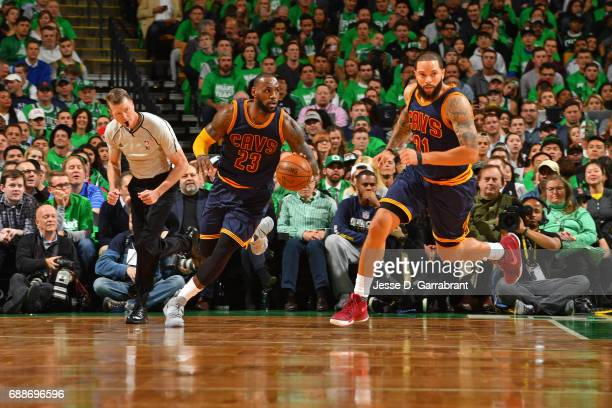 LeBron James of the Cleveland Cavaliers dribbles the ball up court against the Boston Celtics in Game Five of the Eastern Conference Finals during...