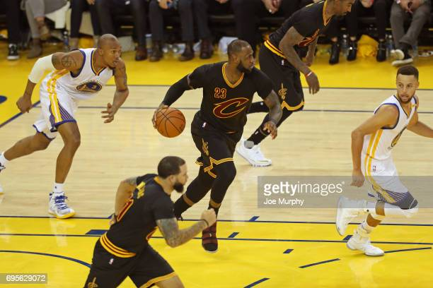 LeBron James of the Cleveland Cavaliers dribbles the ball up court against the Golden State Warriors in Game Five of the 2017 NBA Finals on June 12...