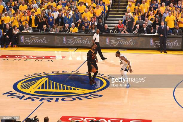 LeBron James of the Cleveland Cavaliers dribbles the ball up court while guarded by Kevin Durant of the Golden State Warriors in Game Five of the...