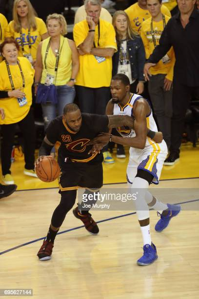 LeBron James of the Cleveland Cavaliers dribbles the ball while guarded by Kevin Durant of the Golden State Warriors in Game Five of the 2017 NBA...