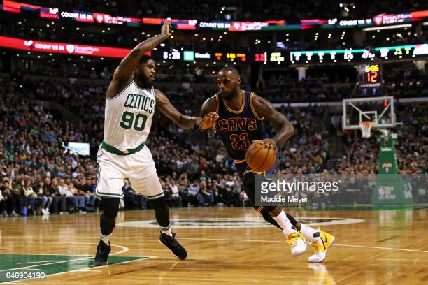 LeBron James of the Cleveland Cavaliers drives against Amir Johnson of the Boston Celtics during the first quarter at TD Garden on March 1 2017 in...