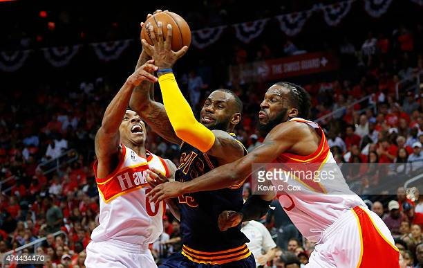 LeBron James of the Cleveland Cavaliers drives against DeMarre Carroll and Jeff Teague of the Atlanta Hawks in the second quarter during Game Two of...